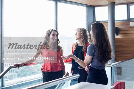 Three businesswomen having informal meeting