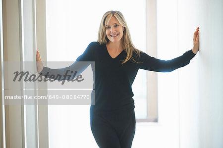 Mature woman standing in corridor