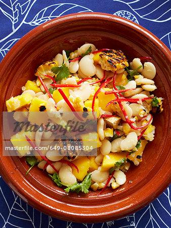 Still life with bowl of sweetcorn and mango salad