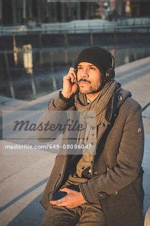 Portrait of businessman listening to headphones