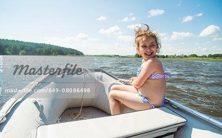 Girl in a dinghy, Rezh River, Sverdlovsk Oblast, Russia