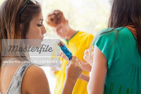 Students having ice lollies