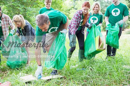 Environmentalist volunteers picking up trash