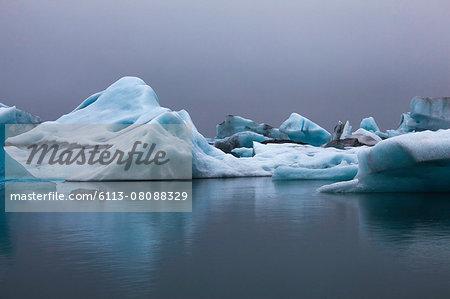 Blue icebergs in calm water, Jokulsarlon, Iceland