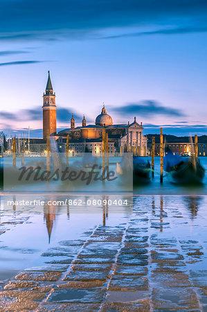 Italy, Veneto, Venice. High tide coming to Riva degli Schiavoni at dawn