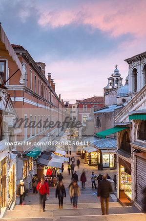 Italy, Veneto, Venice. Souvenir kiosks near Rialto bridge at sunset