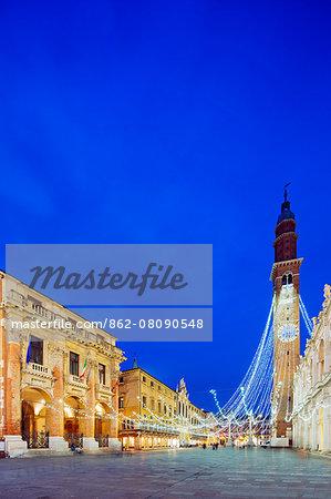 Europe, Italy, Veneto, Vicenza, Christmas decorations in Piazza Signori, clock tower on the Basilica Palladiana, Unesco World Heritage Site