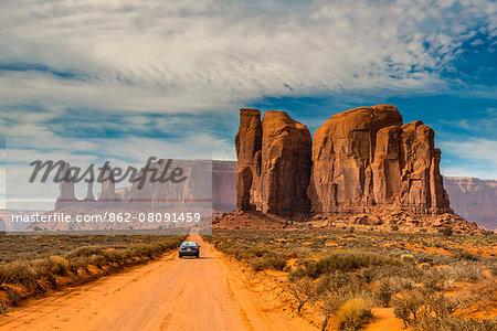 Unpaved road with scenic desert landscape, Monument Valley Navajo Tribal Park, Arizona, USA
