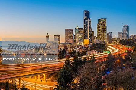 Freeway traffic and downtown skyline at dusk, Seattle, Washington, USA
