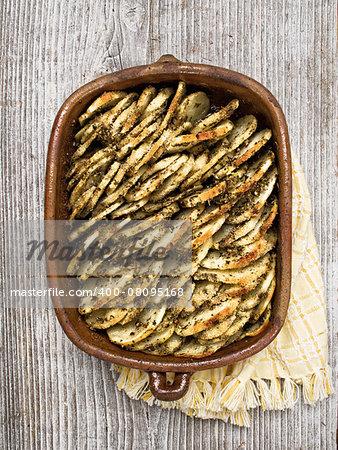 close up of rustic roasted hasselback potato gratin