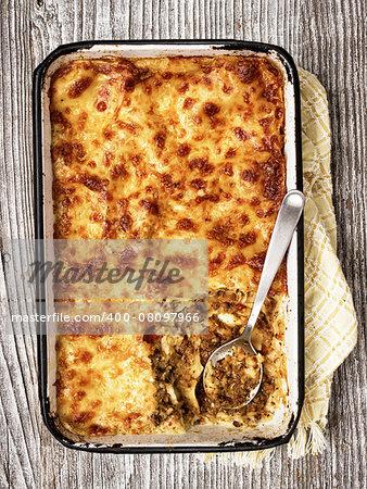 close up of a tray of rustic italian baked lasagna