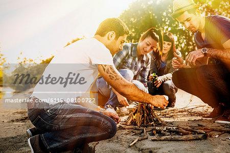 Group of friends lighting a campfire,  Osijek, Croatia