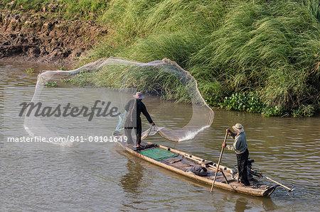 Man casting net on the Tonle Sap River near Phnom Penh, Cambodia, Indochina, Southeast Asia, Asia
