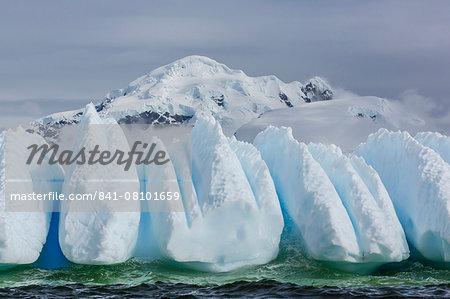 Wind and water sculpted iceberg in Orne Harbor, Antarctica, Polar Regions