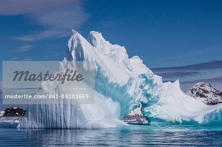 Arch in iceberg, Cierva Cove, Antarctica, Polar Regions