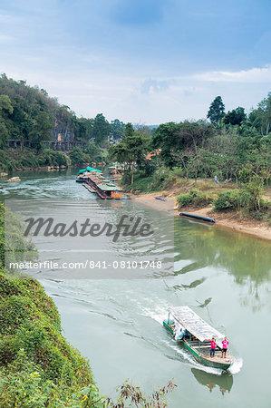 A boat on the River Kwai with the POW-built Wampoo Viaduct behind, Death Railway near Nam Tok, Kanchanaburi, Thailand, Southeast Asia, Asia