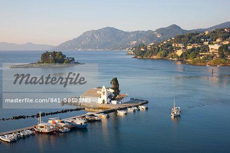 View to the Monastery of Panagia Vlacherna, small boat approaching, Kanoni, Corfu Town, Corfu, Ionian Islands, Greek Islands, Greece, Europe