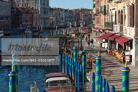 Green and blue mooring poles at the Rialto Bridge, Grand Canal, Venice, UNESCO World Heritage Site, Veneto, Italy, Europe