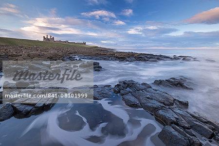 Rocky shores below Dunstanburgh Castle, Craster, Northumberland, England, United Kingdom, Europe