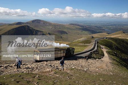Snowdon Mountain Railway train and the Llanberis path, Snowdon, Snowdonia National Park, Gwynedd, Wales; United Kingdom, Europe
