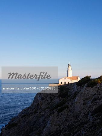 Lighthouse on Coastal Rock at Sunset, Majorca, Balearic Islands, Spain