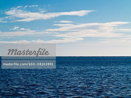 Clouds against Blue Sky over Blue Sea, Majorca, Balearic Islands, Spain