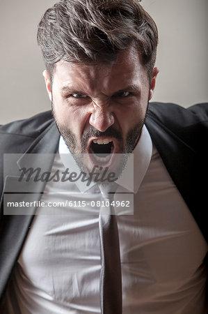 Portrait of businessman screaming