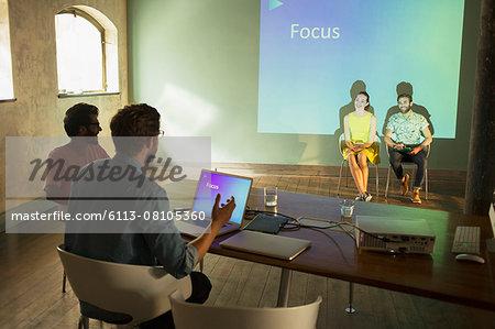 Business people preparing audio visual presentation on Focus