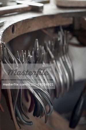 Various pliers hanging in workshop, Bavaria, Germany