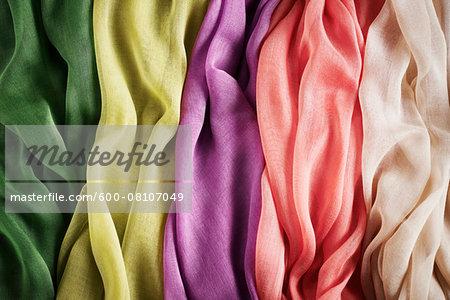 Close-up of five colourful summer scarves, studio shot