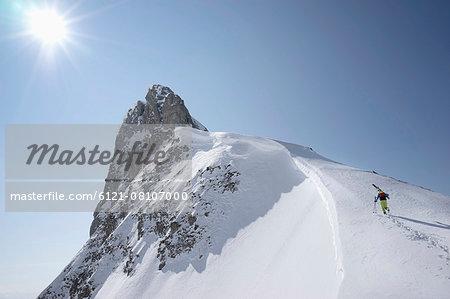Ski mountaineer climbing on snowy peak, Tyrol, Austria
