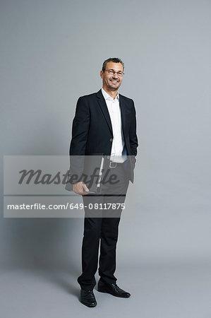 Studio portrait of smiling mature businessman
