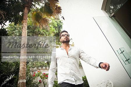 Man walking by door