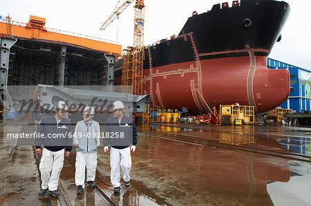 Workers walking through shipyard, GoSeong-gun, South Korea