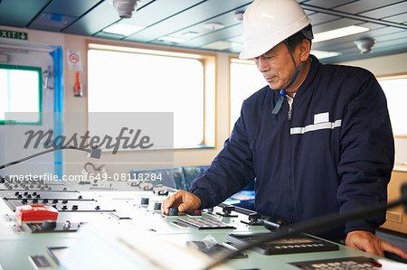 Worker using equipment at shipping port, GoSeong-gun, South Korea