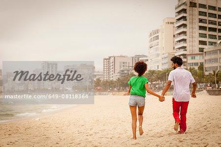 Couple enjoying beach,  Rio de Janeiro, Brazil