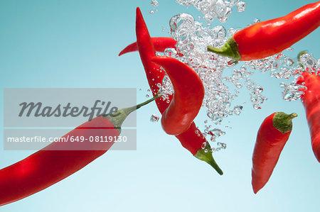 Red chillies underwater