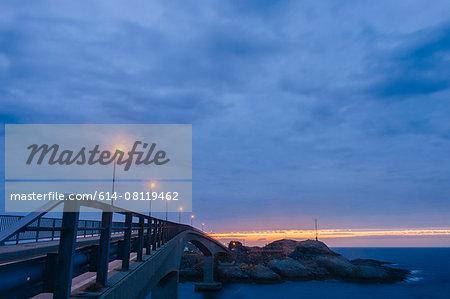 Coastal crossing at dusk, Reine, Lofoten, Norway
