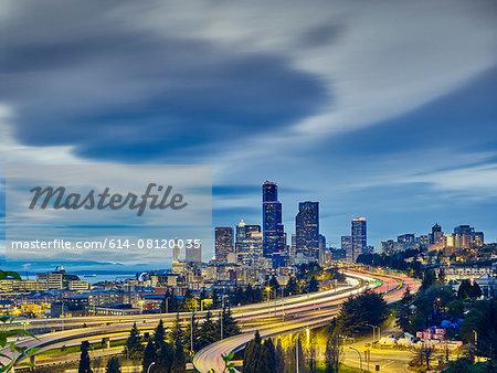 Traffic light trails and cityscape at dusk, Seattle, Washington State, USA