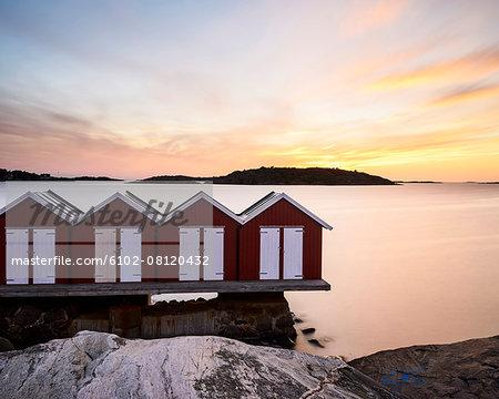 Fishing huts at sunset