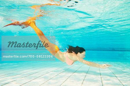 Portrait of Teenage Girl with Mermaid Tail Underwater