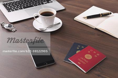 Smartphone coffee and passports