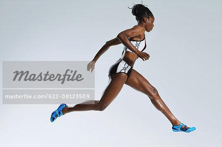 Female Athlete Running, Studio Shot