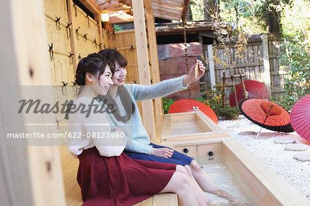 Young Japanese women enjoying foot spa in Kawagoe, Japan
