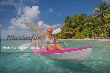 Senior couple in canoe, Maldives