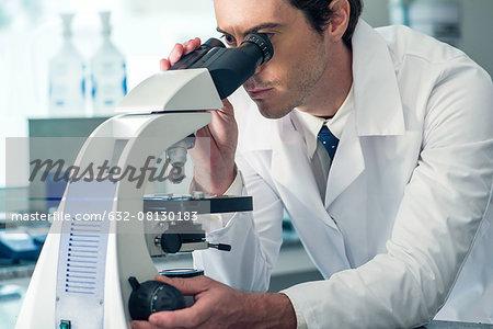 Biologist using microscope