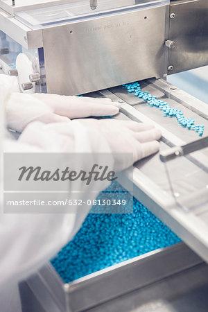 Technician operating blisterpack sealing machine