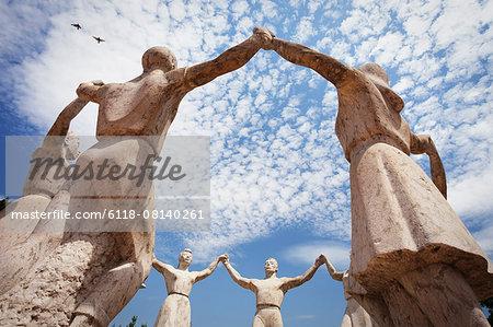 Stone sculptures of the La Sardana Monument in Barcelona.