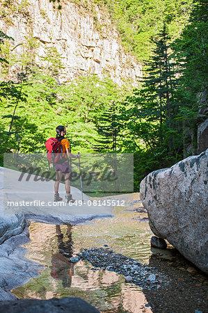 Female hiker looking out to valley on way to Daecheongbong peak,  Seoraksan National Park in South Korea