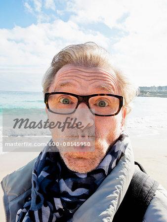 Portrait of Senior Man Outdoors making a Face, Spain